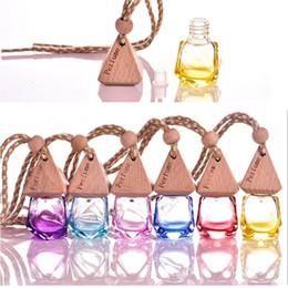 essência óleos frete grátis Desconto 6 ml carro pendurar decoração essência de vidro óleo garrafa de perfume pendurar corda pequena garrafa de vidro vazio frete grátis 027