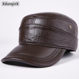 XdanqinX 2018 Winter New Style Genuine Leather Warm Hat Men s Cowhide Baseball  Caps With Earmuffs Adjustable Size Flat Top Cap 38c43794f01c