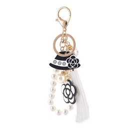 pearl key charm Coupons - New Pearl Flower Keychain Fashion Hat Tassel Car Key Ring Female Bag Pendant Accessories Girl Gift Charm Jewelry Key chain