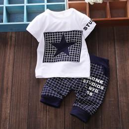 vestuário idade 12 Desconto Conjuntos de bebê O Star Child Xadrez T Shirt + calças 2 pc Terno Menino e Menina Crianças Ternos de Roupas Esportivas 0-2 Idades Frete Grátis
