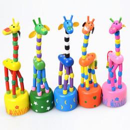 Argentina Bebé de madera jirafa de roca juguete de pie bailando muñeca de mano 18cm alto animal de juguete para niños 'V15032304 Suministro