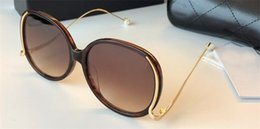 Wholesale Pearl Frame Round - Wholesale new fashion designer sunglasses round frame metal legs with pearl simple popular summer style uv400 protection eyewear for women