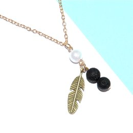 Wholesale Feathers Necklaces - 12pcs lot bronze tone Feather Lava Essential Oil Necklace Diffuser Lava Rock Aromatherapy Jewelry