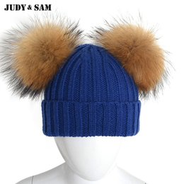7e2b1b87888 New Designal Child Winter Wool Blended Knit Stripe Cap With 2 Natural Color  Real Raccoon Fur Pom Poms Kids Hat For Boys