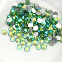 Luz verde AB SS3-SS20 Nail Art Crystals No Hot Fix Rhinestone Flatback piedra suelta para DIY uñas decoración desde fabricantes
