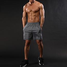 2018 pantalones deportivos elásticos Sporting Summer Men Shorts Joggers  Entrenamientos Gimnasio Culturismo Loose Fitness Cintura elástica 1dc08460d77