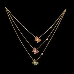Canada Collier de trèfle à quatre feuilles de bijoux jaune vert rose orange avec perceuse oblique Collier de Quatrefoil papillon pour cadeau de femmes Offre