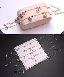 Piatti di cloisonne online-2018 Nuovi multi disegni misti Bracciale in acciaio di titanio PU fili in oro rosa placcato donne gioielli Bangle