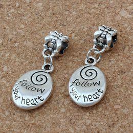"Wholesale Ancient Heart - MIC .100pcs lot Dangle Ancient silver Alloy Oval "" follow your heart ""charm Big Hole Beads Fit European Charm Bracelet Jewelry 12.5x32.5mm"