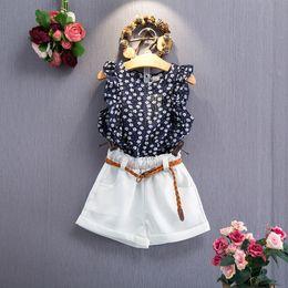 Kinder ärmellose weiße t-shirts online-Mädchen Sommer Outfits ärmelloses T-Shirt mit Blumendruck + weiße Shorts Hosen 2er Set Mädchen Kleidung Set Kinder Outwear Set mit Gürtel