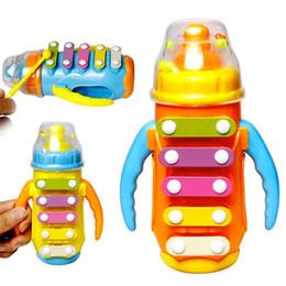 led produits en plastique Promotion Enfants Nourrir Bouteille Forme Battre Éclairant Jouet Bébé Petite Enfance Intelligence Bell Instruments De Musique Noisemaker Piano Jouets 5