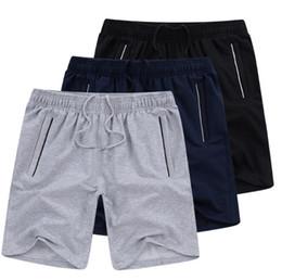 Talla 46 ropa online-Pantalones cortos deportivos Ropa de talla grande Pijamas Hombres Verano Pantalones cortos casual sólidos Pantalones cortos sueltos finos