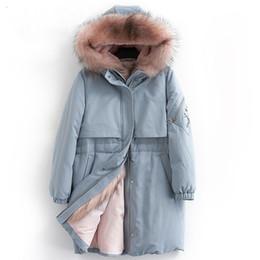 реальная отделка капота Скидка Вниз пальто женщины зима толстые теплые 90% белая утка пуховик женский реальный енот меховой отделкой капот дизайн моды NPI 81029C
