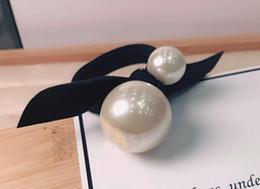 Canada 2018 style populaire nouveau sur le marché en Corée du Sud a importé une véritable double perle en cuir cheveux anneau de cheveux ornements coiffures corde corde à la main cheap import south korea Offre