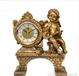 Wholesale Al por mayor Moda Decoración para el hogar Artesanías de resina Reloj de escritorio Reloj antiguo europeo Lectura dorada Ángel Estatua Reloj Reloj de mesa