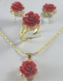 Collar colgante de coral rojo online-hermoso 12 mm rojo coral tallado pendientes de flores anillo collar colgante