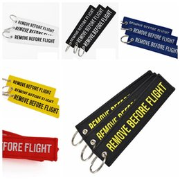 Wholesale Fabrics Wholesalers - new Keychain REMOVE BEFORE FLIGHT Embroidered Canvas Color Optional Keyring Luggage Tag Label Aviation Fashion Accessories GGA233 200PCS