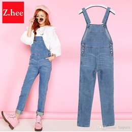 f6b59bebb27 Wholesale- 2017 Loose New Denim Jumpsuits Pocket Rompers Stripped Loose Plus  Size Women Fashion Casual Denim Overalls Harlan Jumpsuits