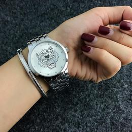 Tigerband online-Beliebte Marke KEN Tiger Stil Marke Frauen Mädchen Stahlband Quarz Armbanduhr KE02