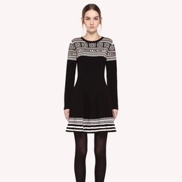 Argentina Vestidos de lana de mujer Winter Runway 2018 Estilos de vestir de suéter con estampado africano de alta calidad Vestido de manga larga delgado Mini vestido femenino Suministro