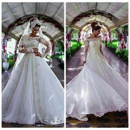 Argentina 2019 Bateau de manga larga de encaje apliques vestido de bola vestidos de novia árabe formal Dubai Vestios De Vogue vestidos de novia E22 cheap sexy vogue wedding dress Suministro