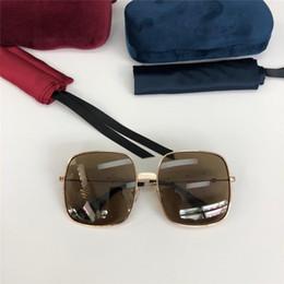 lunettes de soleil lentilles réfléchissantes Promotion Nouveaux lunettes de soleil de créateur de lunettes de soleil carrées à verres réfléchissants protecteurs UV400 ultra-légères top qualité 0414