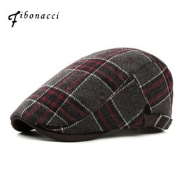 ac7a5a5dd76 Fibonacci Spring autumn fashion women s men s beret Cap wool grid Beret  hats for men women top quality Flat Caps discount brown beret hat