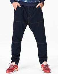 Americano hip hop baggy tamanho grande calça jeans estudante do sexo masculino pequeno pé harem pants pendurar as calças virilha maré masculino gordo de Fornecedores de jeans baggy americano