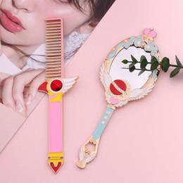 Anime Métal Ovale À La Main Maquillage Miroir Dames Fille Couronne Miroir Oiseau Tête Peigne Commode Rouge Bleu Maquillage Avec Cristal ? partir de fabricateur