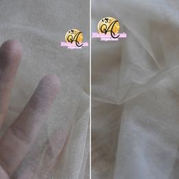 Canada 160 CM largeur faiblement perle ivoire super Transparent gaze épais doux haute couture tissu maille tissu robe de mariée voile tulle tissu SR10 Offre