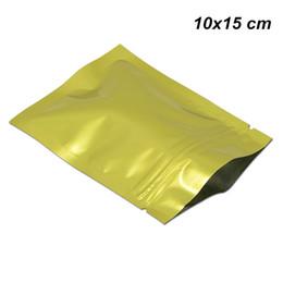 Paquete de oro online-100 unids / lote Oro 10x15 cm (3.9x5.9 pulg.) Sellado Térmico de Mylar Reclosable Paquetes de muestra Papel Aluminio Ziplock Bolsa para Galletas Bolsa de Papel Dulce