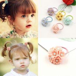 Moda encantadora niñas niños flor rosa elástica banda de pelo elástico cuerda de pelo bebé niños accesorios para el cabello desde fabricantes