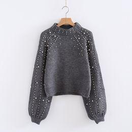 Pantalones cortos suaves de mujer online-Otoño perla con cuentas de punto suéter mujer linterna manga suelta suéter corto femenino suave cálido suéter de cuello alto 2018