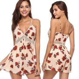 b9d8edf2f359 Womens Floral Print Backless Ladies Summer Romper Shorts Jumpsuit