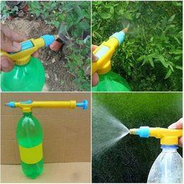 Vendite !!! 2018 Vendite calde Mini Bottiglie di succo Interfaccia di plastica del carrello Pistola spruzzatore Testa Water Watering Equipments da
