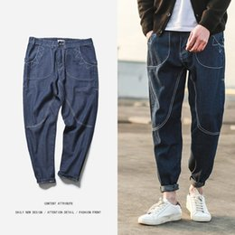 Hombre Biker Jeans Hombre 2018 Primavera y verano Nuevo corte lavable Moda Jeans  Loose Fitness Joggers pantalones Hip Hop Pants 08ab74bedca