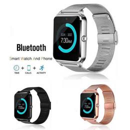 medidor de ips Rebajas Bluetooth Z60 Reloj inteligente Relojes inalámbricos Relojes inteligentes Acero inoxidable para IOS Android Soporte de tarjeta SIM TF Cámara Rastreador de ejercicios con caja al por menor