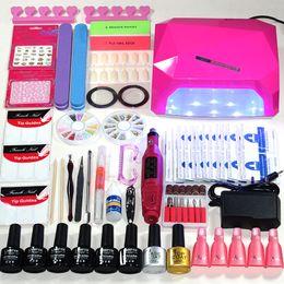Juego de manicura elegir 6 colores Gel Polish Base Top Coat Kits de uñas 36w lámpara led uv Kit de manicura eléctrica Manija desde fabricantes