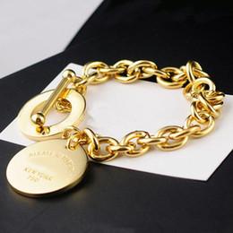 Ot bracelete on-line-Atacado top quality titanium aço amor pulseira marca NOVA YORK rodada OT marca fecho da lagosta dupla t pulseira para as mulheres transporte da gota