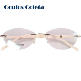 1e70f04418 Titanium eyeglasses frames for women high quality optical glasses frame  2018 butterfly cat eye top fashion rimless frameless