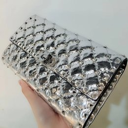 Wholesale skulls spike rivets - fashionville~top quality~w201 silver genuine leather spike clutch bag chain bag 23.5*14.5*4.5cm