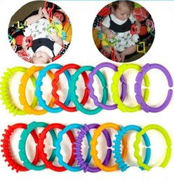 Wholesale play toys cars - 24pcs lot plastic baby kids infant rainbow teether ring links stroller gym play toy kids baby soft toys baby car around hanging ring