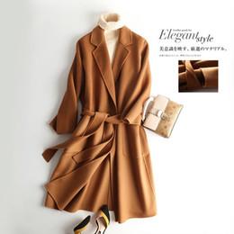 Abrigo de camello de cachemir de las mujeres online-Cachemira moda otoño Camel chaqueta de mujer vintage 2017 invierno largo abrigo de lana diseñador con cinturón de bolsillo de lujo