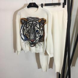Argentina Designer 2018 Black / White / Grey Tiger Lentejuelas Beads Jerseys y pantalones largos Marca Same Style2 Unidades Conjuntos para mujer y hombre 837899 Suministro