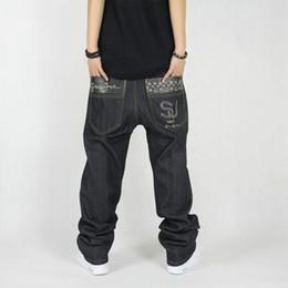 Pantalones negros altos online-Otoño Invierno Jeans Talles Grandes Nueva Moda Casual Jeans Negro Mens Joggers Loose Denim Harem Pants Hip Hop Pantalones Skateboard
