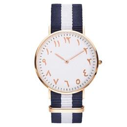 Top De Luxe Marque De Mode Stripe Nylon Femmes Montre Hommes Quartz Montre-Bracelet De Mode Numéros Arabes Montre Montre Femme Horloge Femelle ? partir de fabricateur