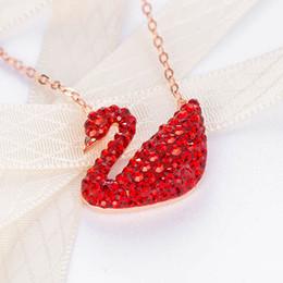 Multicolor súper calidad superior de las mujeres collar de regalo de la personalidad femenina de cristal cisne collar colgante hueso cadena moda collar de oro rosa desde fabricantes