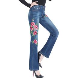 Fiore di campana blu online-WZJHZ 2018 Nuova donna Jeans Bell Bottom Jeans ricamati ad alta elasticità delle donne svasati Pantaloni da donna Fiori ricamo blu