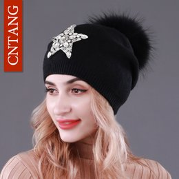 d71d060beba CNTANG Autumn Knitted Wool Hats For Women Winter Warm Caps With Star  Rhinestones Natural Raccoon Fur Pompom Hat Female Beanies