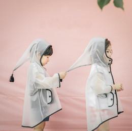 Nueva lluvia Ponchos niño con capucha de la borla de dibujos animados para niños bebé impermeable impermeable lindo ropa impermeable al por mayor envío gratuito desde fabricantes